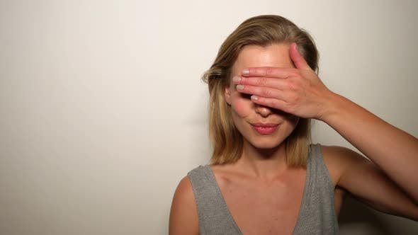 Thumbnail for Blonde Model Doing the Peek-A-Boo Gesture