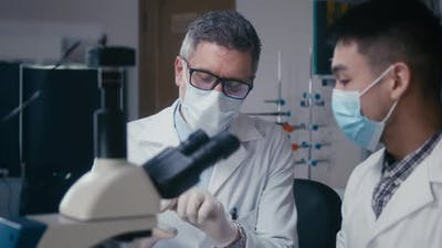 Professor and Student Discussing in Laboratory