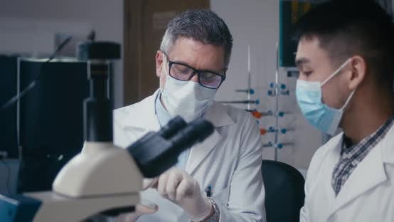 Thumbnail for Professor and Student Discussing in Laboratory