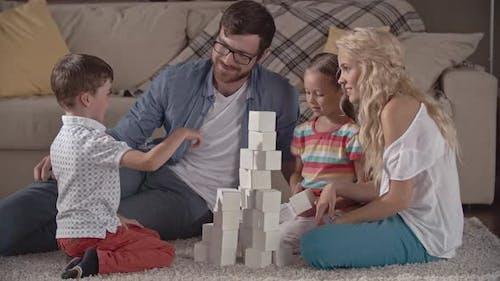 Family Stacking Bricks