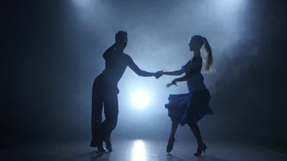 Thumbnail for Professional Couple of Salsa Dancers Posing in Smoky Studio, Silhouette