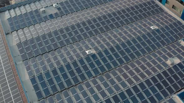 Thumbnail for Aerial Drone View Flying Over Warehouse with Solar Panels, Sunny Batteries