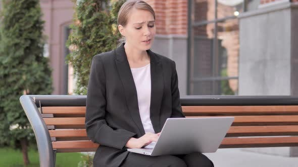 Cover Image for Young Businesswoman Frustrated by Failure, Sitting on Bench