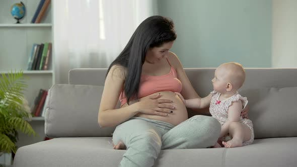 Thumbnail for Future Mother Waiting for Birth of Baby, Cute Child Touching Pregnant Belly