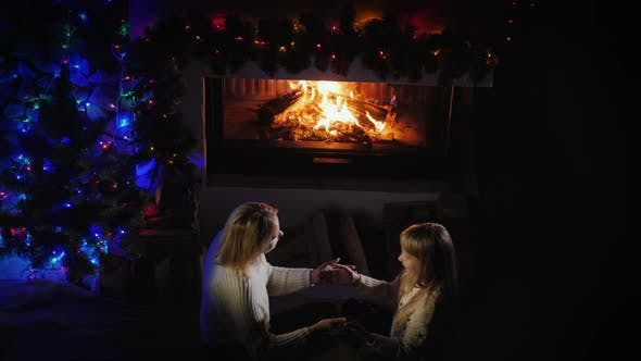 Cover Image for Woman Playing with Child By the Fireplace, Have a Nice Christmas Party Together