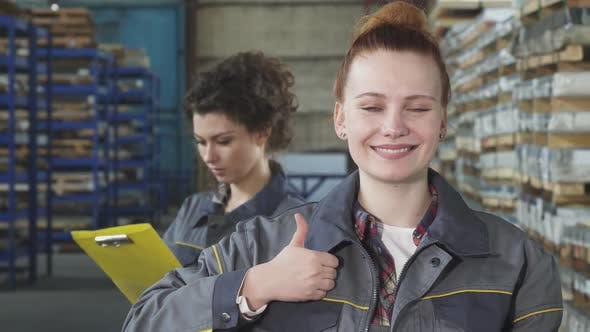 Thumbnail for Happy Beautiful Female Engineer Smiling Showing Thumbs Up at the Warehouse