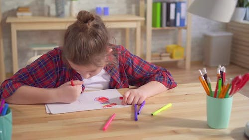 Portrait of a Lonely Child Autism or Having Mental Disorders Draws Sitting at a Table
