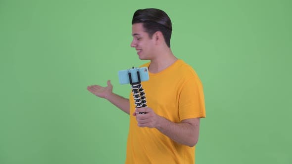Thumbnail for Happy Young Multi Ethnic Man Vlogging and Showing Phone