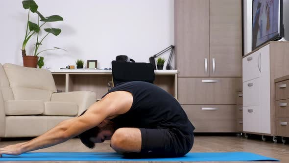 Thumbnail for Man Doing Different Yoga Poses on a Blue Mat in His House