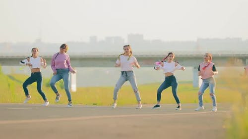 Fashionable Dance Synchronously Dancing Hiphop at the Bridge in the Summer