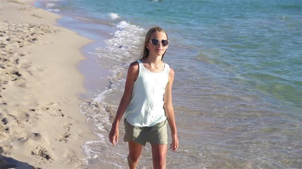 Thumbnail for Adorable Little Girl at Beach During Summer Vacation