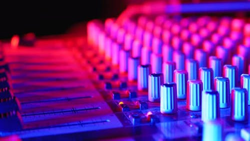 Working on Sound Mixing Console at the Dj Party in Night Club