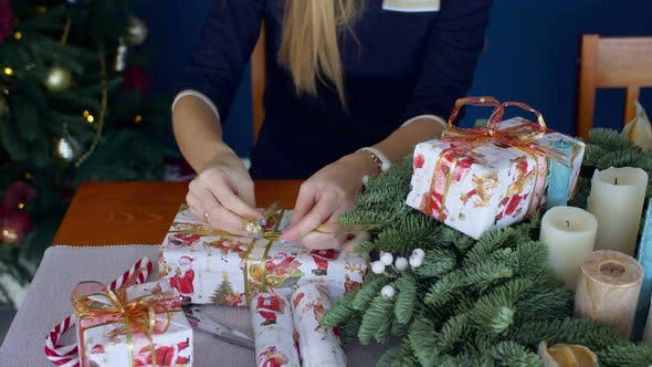 Female Hands Wrapping Christmas Presents