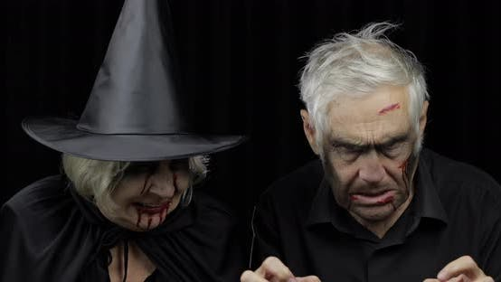 Thumbnail for Elderly Man and Woman in Halloween Costumes. Witch and Zombie