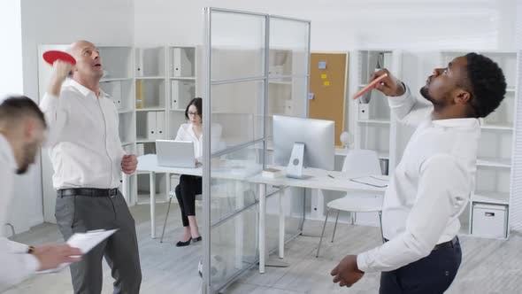 Cover Image for Work-Shy Colleagues Playing Ping-Pong in Office