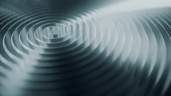 Cover Image for Rotating Grey Coil