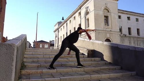 Experienced Ballet Dancer Performs on Old City Stone Stairs