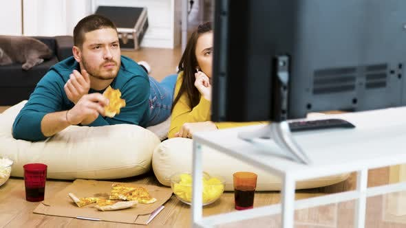 Thumbnail for Revealing Shot of Young Couple Watching Tv