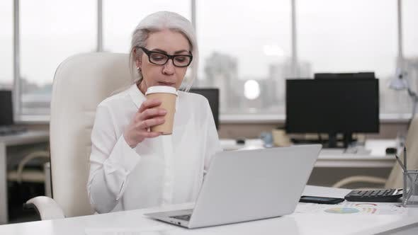 Ambitious Caucasian Career Woman Working Late Alone in Office
