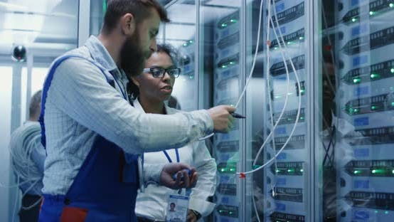 Thumbnail for Three People Working in a Data Center