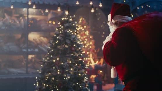 Thumbnail for Santa Claus in Mask Walking Quietly Near Christmas Tree