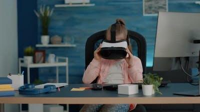 Schoolgirl Using Vr Glasses for Homework and Learning at Desk