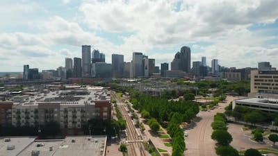 Aerial Drone View of Wide Skyline From Drone Ascending Above Low Houses in Neighborhood