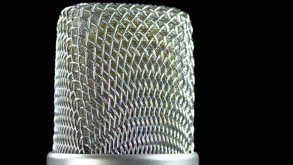 Thumbnail for Studio Condenser Microphone Rotates on a Black Background