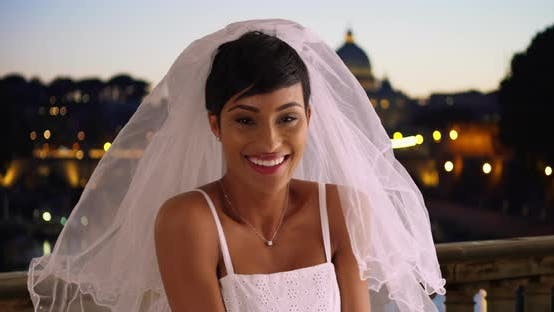 Thumbnail for Happy beautiful bride in Rome, Italy lifts away her veil laughing and excited
