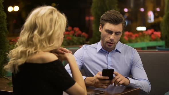 Thumbnail for Woman Trying to Attract Attention of Her Boyfriend Who Actively Working on Phone