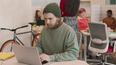 Hipster Businessman Working in Start-Up Office