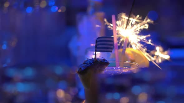 Thumbnail for Bar Cocktails with Sparkler and Greek Flag