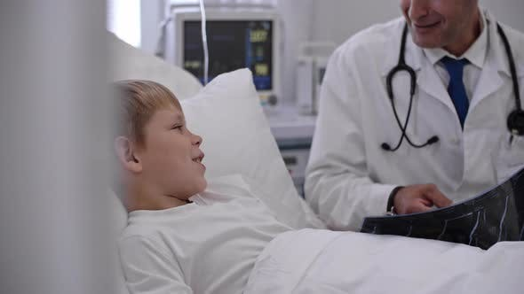 Thumbnail for Doctor Explaining Little Boy X-Ray Results