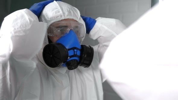 Thumbnail for Scared and shocked doctor or virologist in bio suit and
