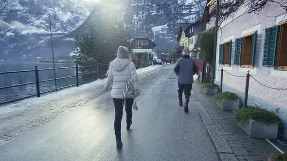 Thumbnail for Woman walking on the waterfront of Hallstatt Lake