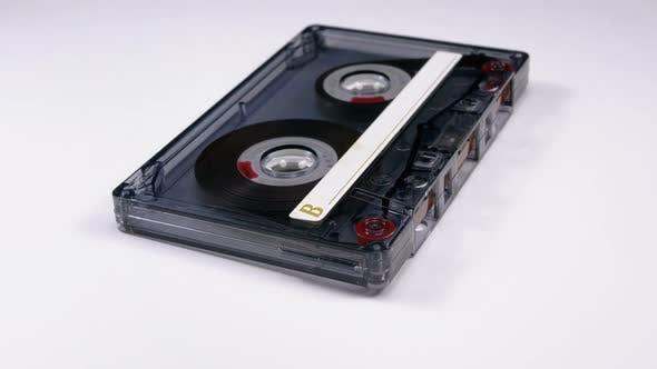 Thumbnail for Vintage Transparent Audio Cassette Rotates on White Background
