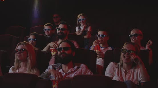Thumbnail for Moviegoers Watching Comedy Movie in Cinema