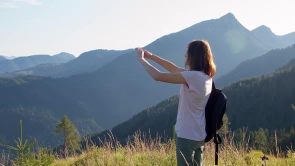 Thumbnail for Female Tourist Taking a Photo on Top of a Mountain