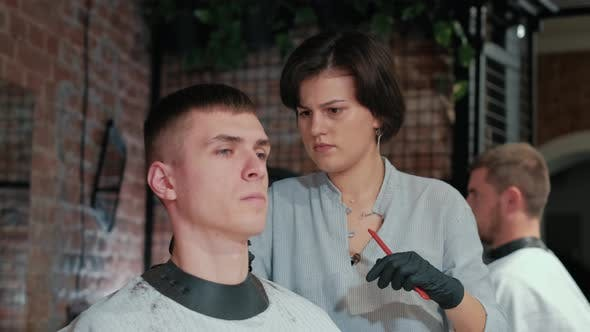 Thumbnail for Barber Cuts the Hair of the Client with Scissors Close-up. Frame. Barber Combing Hair and Cutting