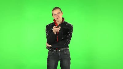 Guy with TV Remote in His Hand, Switching on TV. Green Screen