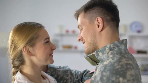 Cheerful Woman Hugging Loving Soldier Husband, Homecoming After War, Reunion