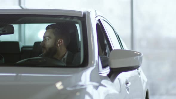 Thumbnail for Man and Woman Sitting in Car and Talking
