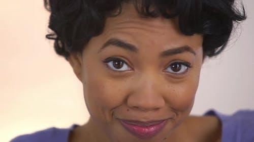 Black woman pretending to accidentally swallow bubble gum