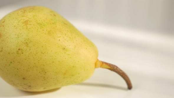 Thumbnail for Pear fruit background 4K 2160p UHD video - Tasty fruit on white background 4K 3840X2160 UHD footage