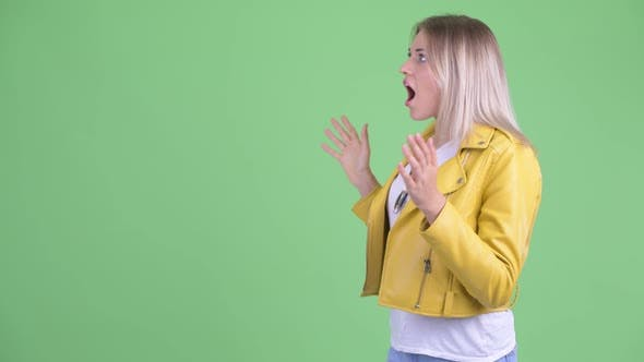 Thumbnail for Happy Young Rebellious Blonde Woman Touching Something and Looking Surprised