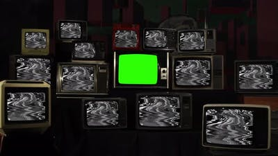 Retro TV turning on Green Screen Amidst Many Old TVs with Glitched Screens. 4K.