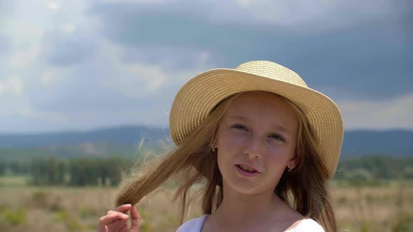 Thumbnail for Cute Teen Girl Standing on Summer Field and Speaking at Camera