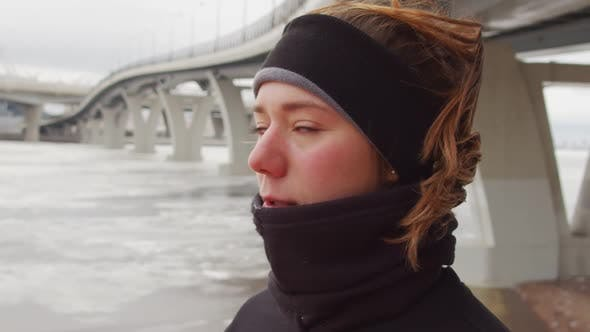 Thumbnail for Portrait of Young Woman in Sportswear on Lakeshore on Winter Day