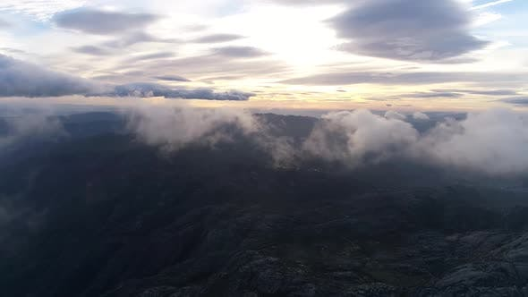 Flying Above Cloudy Alps Valley In A Day Time