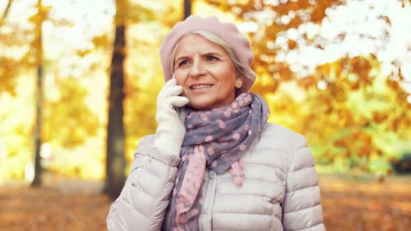 Thumbnail for Senior Woman Calling on Smartphone at Autumn Park 7
